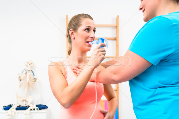 Woman taking pulmonary function test with mouthpiece in her hand Stock photo © Kzenon