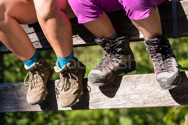 Two children with hiking boots sitting on rail of bridge  Stock photo © Kzenon