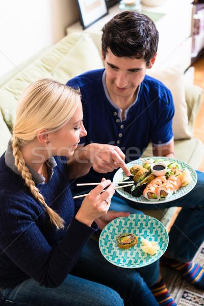 Jonge kaukasisch paar eten asian traditioneel Stockfoto © Kzenon