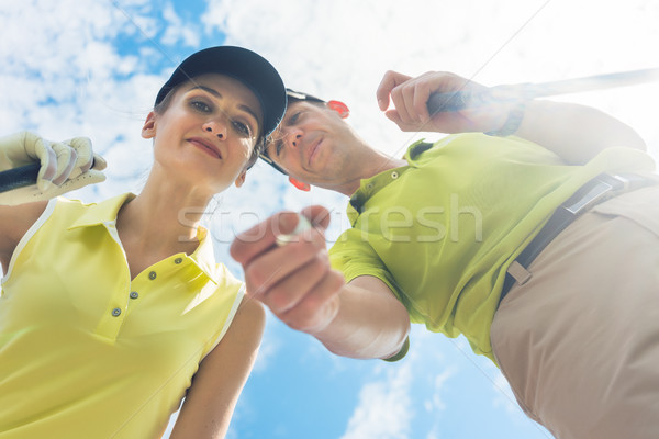 Stock photo: Portrait of a young woman smiling during professional golf game