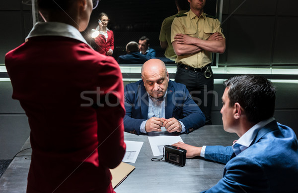 Stock photo: Middle-aged man thinking about his statement and the criminal ch