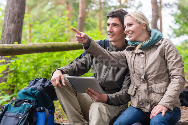 Hikers determinating their position by GPS on tablet PC Stock photo © Kzenon
