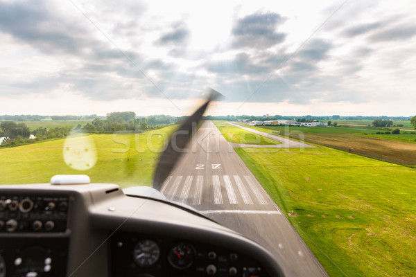 Sport pilot landing on airfield strip Stock photo © Kzenon