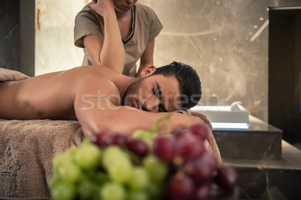 Young man lying down during traditional acupressure procedure Stock photo © Kzenon