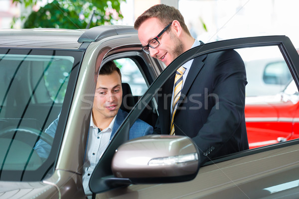 Customer buying new car in auto dealership  Stock photo © Kzenon