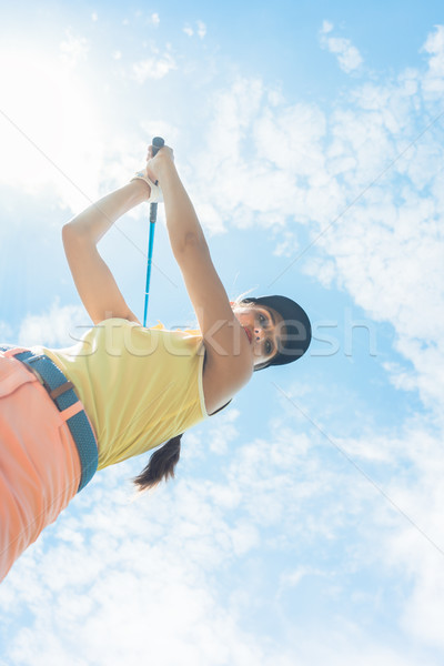 Female professional player holding up the iron club while playing Stock photo © Kzenon