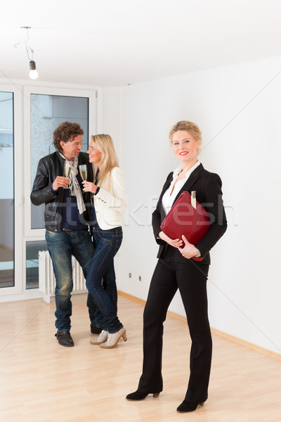 Young couple looking for real estate with female realtor Stock photo © Kzenon