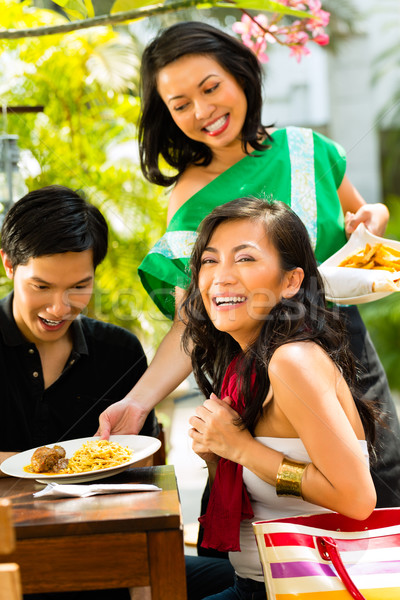 Stock photo: Asian man and woman in restaurant