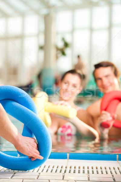 Fitness - sports gymnastics under water in swimming pool Stock photo © Kzenon