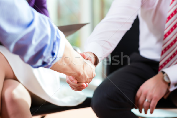 Stock photo: Man shaking hands with manager at job interview closeup cutout