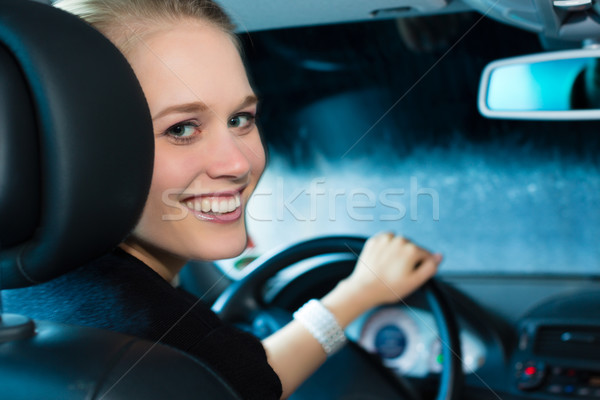 Young woman drives car in wash station Stock photo © Kzenon
