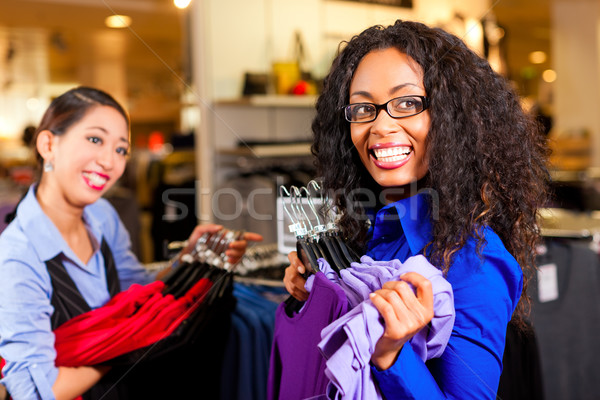 Women in a shopping mall with clothes Stock photo © Kzenon