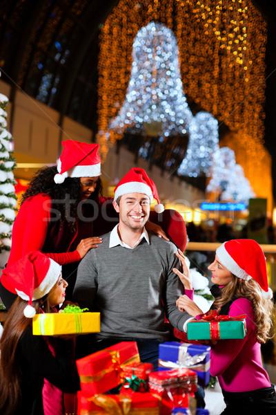 Modern Santa Claus in Shopping mall Stock photo © Kzenon