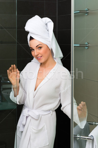 Young woman in bathrobe in hotel bathroom Stock photo © Kzenon