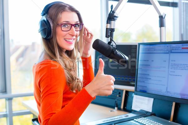 Female radio presenter in radio station on air Stock photo © Kzenon