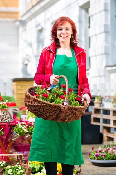 Florist delivering basket of flowers or viola Stock photo © Kzenon