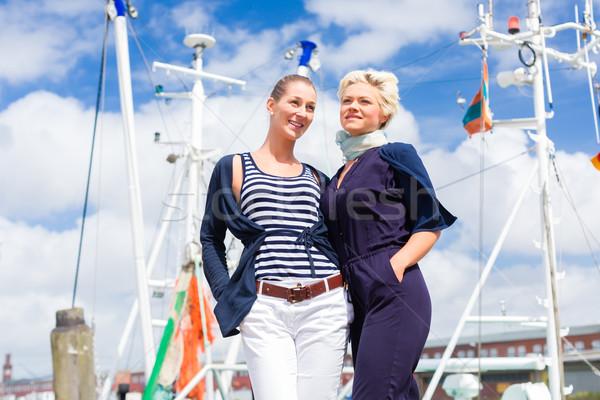 Friends standing at marina pier  Stock photo © Kzenon