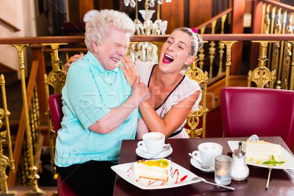 Nagyi leányunoka nevet kávézó idős nő Stock fotó © Kzenon