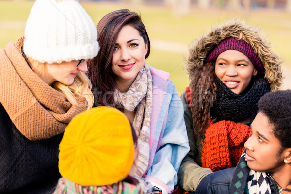 Young people having a good time together outdoors Stock photo © Kzenon