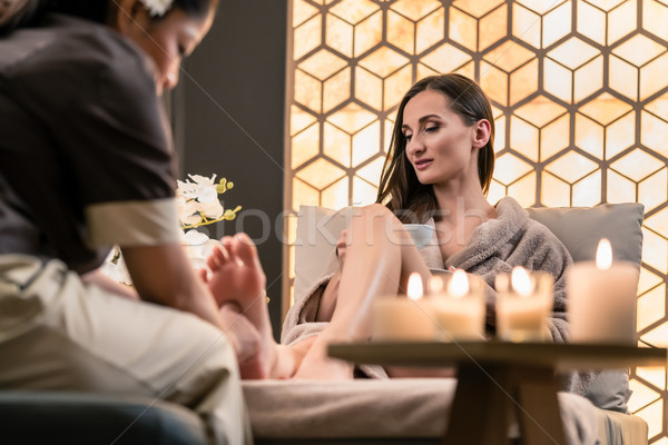 Therapist massaging the foot of a female client in Asian beauty  Stock photo © Kzenon