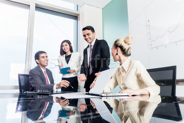 Group of businesswomen and businessmen negotiate contract Stock photo © Kzenon