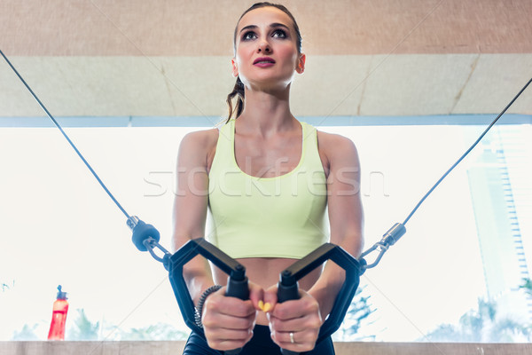 Low-angle view portrait of a cheerful beautiful woman exercising Stock photo © Kzenon