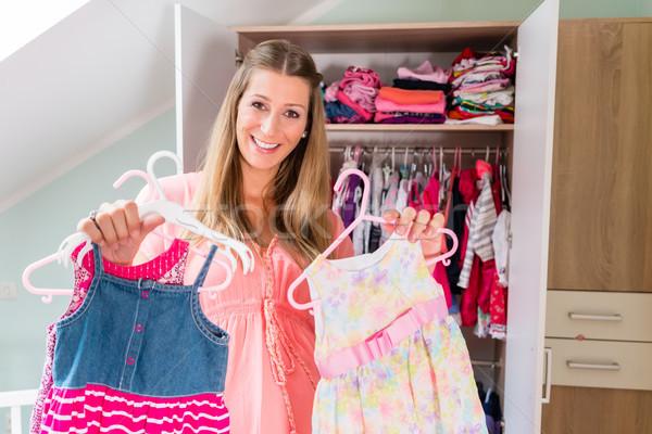 Pregnant woman in front of wardrobe in childs room Stock photo © Kzenon