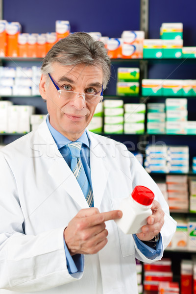 Pharmacist in pharmacy with medicament Stock photo © Kzenon