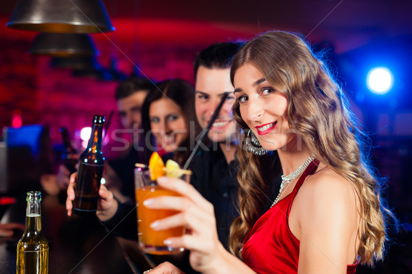 People with cocktails in bar or club Stock photo © Kzenon