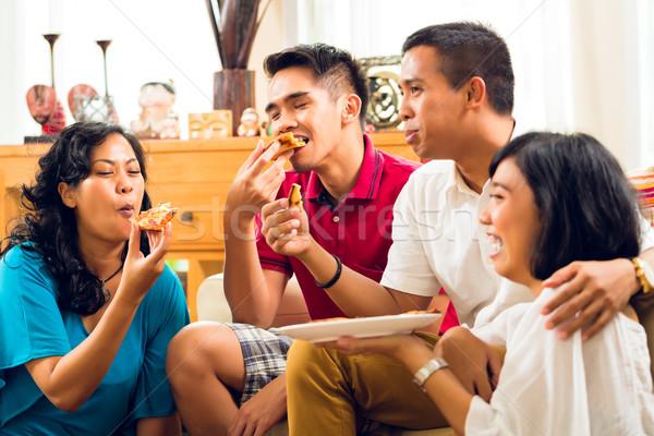 Asian mensen eten pizza partij diner Stockfoto © Kzenon