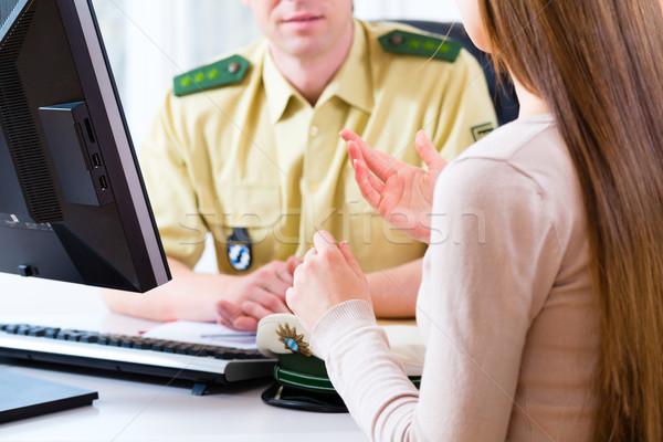 Police officer in department registering complaint  Stock photo © Kzenon