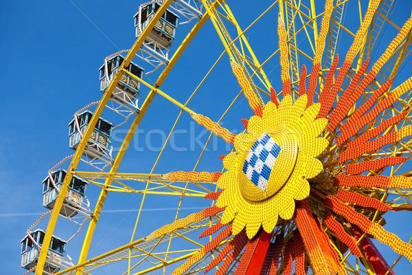 Big wheel in front of blue sky  Stock photo © Kzenon