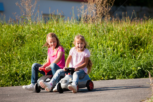 Two sisters with toy cars Stock photo © Kzenon
