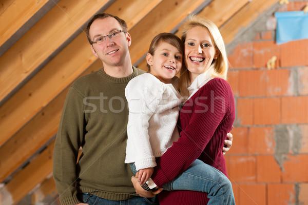 Young family on a construction site Stock photo © Kzenon