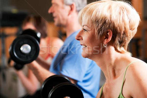 Três senior pessoas ginásio duas mulheres um Foto stock © Kzenon