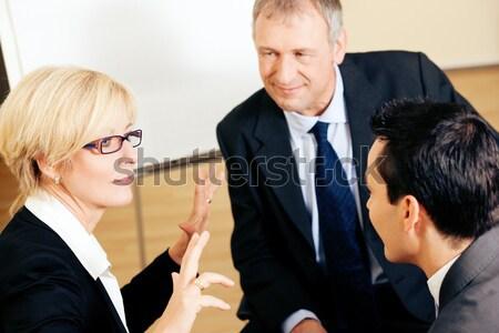 Zakelijke bijeenkomst twee mannelijke vrouwelijke vergadering Stockfoto © Kzenon