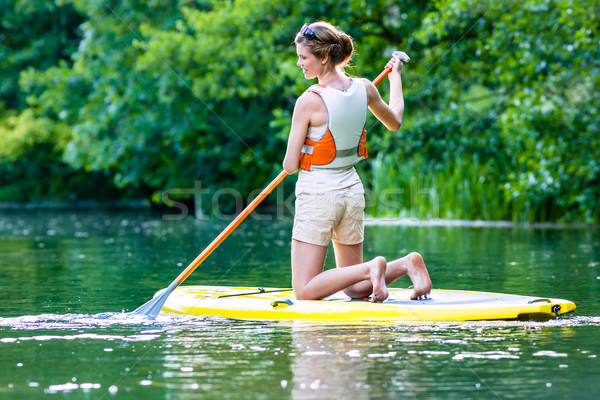 Woman with stand up paddle board sup on river Stock photo © Kzenon