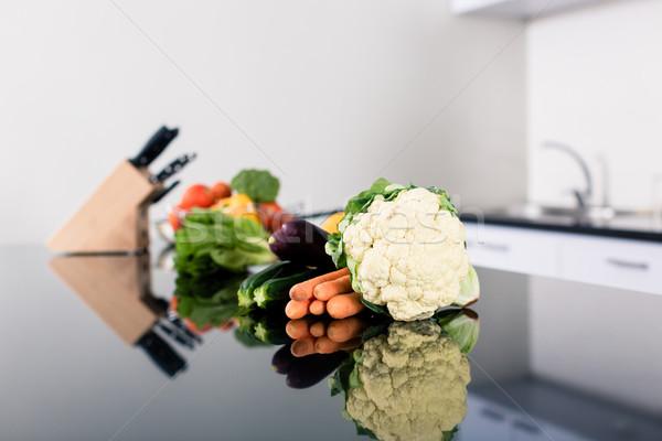 Vegetables on kitchen counter in stylish apartment Stock photo © Kzenon