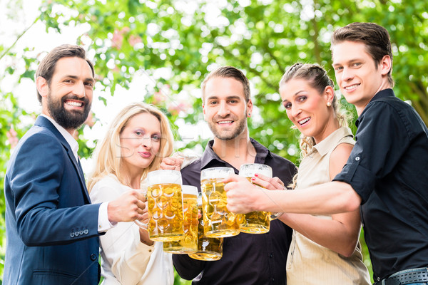 Friends or colleagues on beer garden after work Stock photo © Kzenon