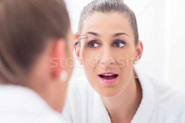 Kobieta łazienka twarz kobiet oczy Zdjęcia stock © Kzenon