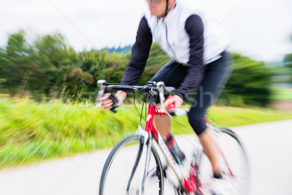 Fast Sport Bicyclist on bike with motion blur Stock photo © Kzenon