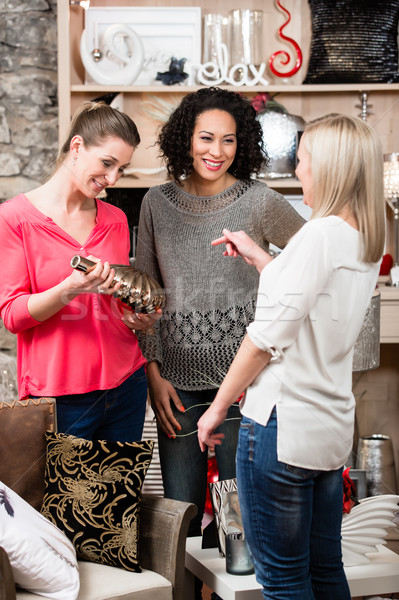 Friends in boutique discussing purchase of new dust catcher Stock photo © Kzenon
