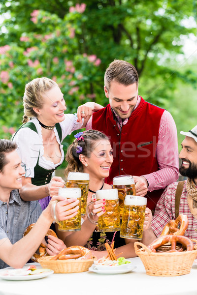 In Beer garden - friends drinking beer in Bavaria Stock photo © Kzenon