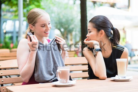 Vonzó nő mutat barát húz fekete fehérnemű bevásárlószatyor Stock fotó © Kzenon