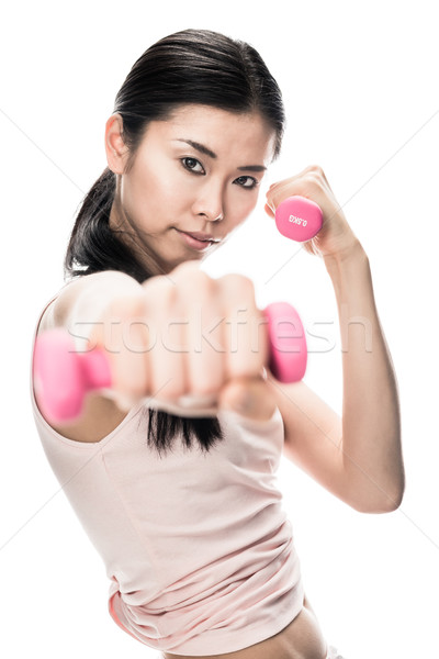 Young determined woman holding small dumbbells Stock photo © Kzenon