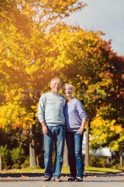 Jesienią spadek spaceru strony człowiek Zdjęcia stock © Kzenon