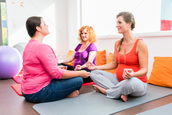 Midwife coaching expectant mothers during relaxation exercises i Stock photo © Kzenon