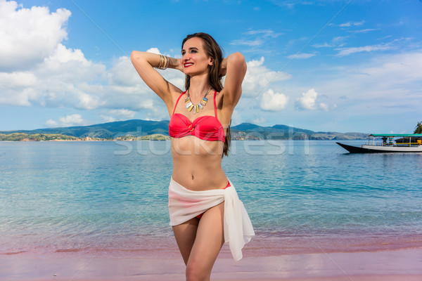 Attractive woman wearing trendy swimwear and accessories during  Stock photo © Kzenon