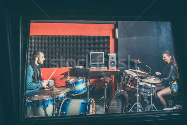 Woman receiving drum lessons from her music teacher Stock photo © Kzenon
