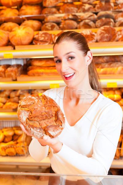 Female baker in her bakery Stock photo © Kzenon